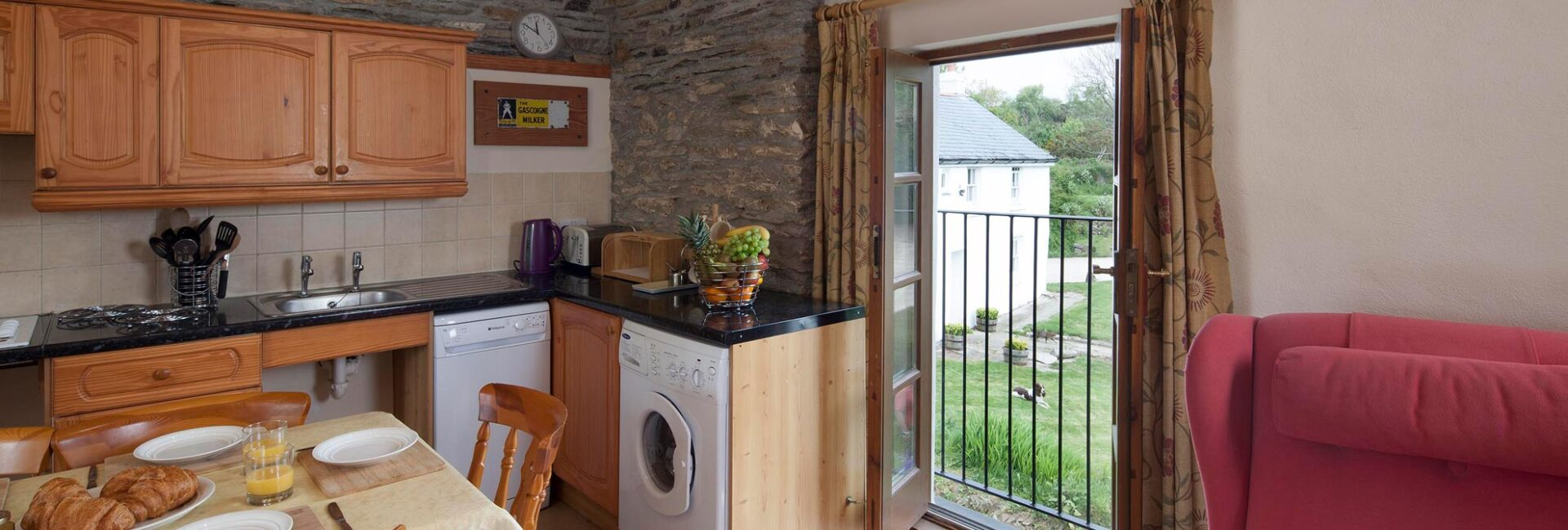 Valley View kitchen with washing machine, dishwasher, clear underspace to the hob and sink, french doors and electric riser recliner chair